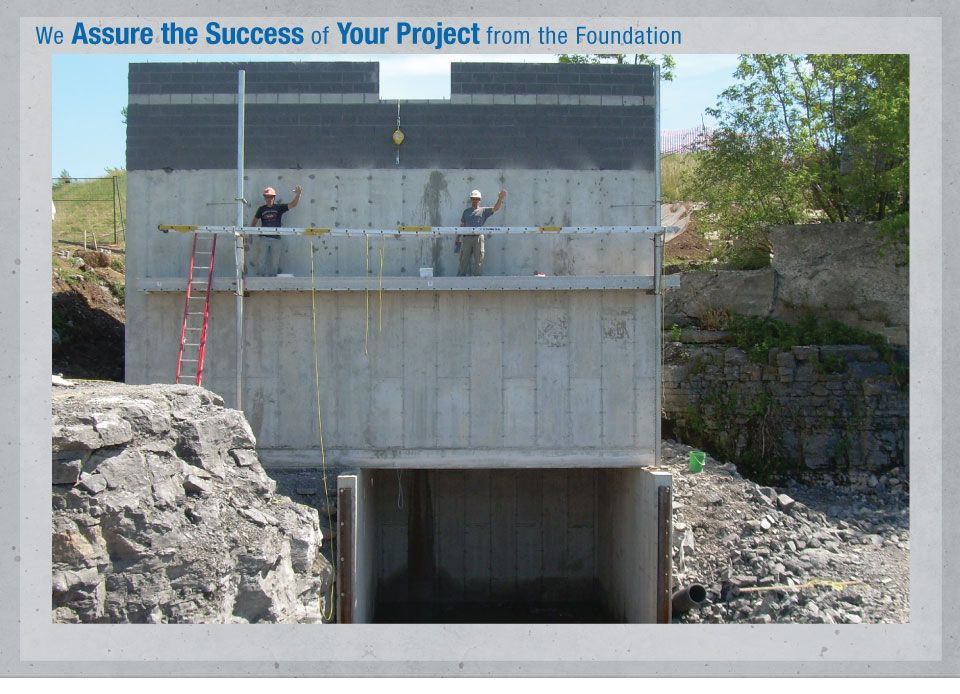 We Assure the Success of your Project from the Foundation - Workers on a concrete wall